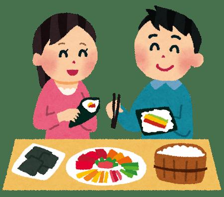 手巻き寿司を食べるカップル